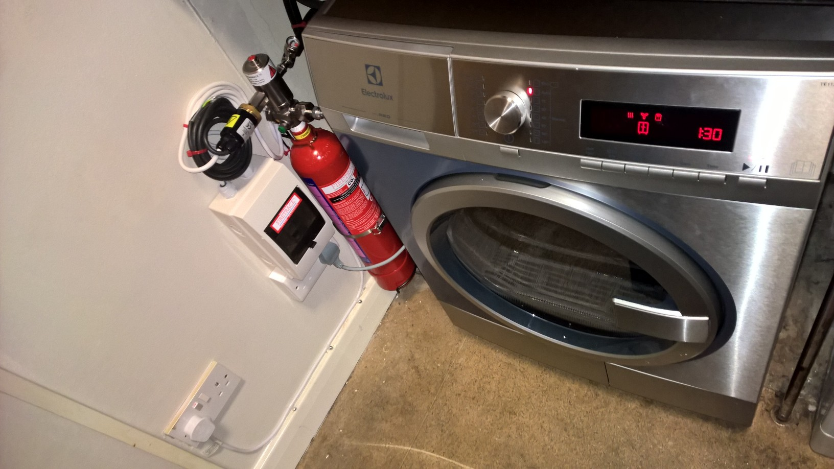 Firetrace Fire Suppression System Installed onto a tumble dryer